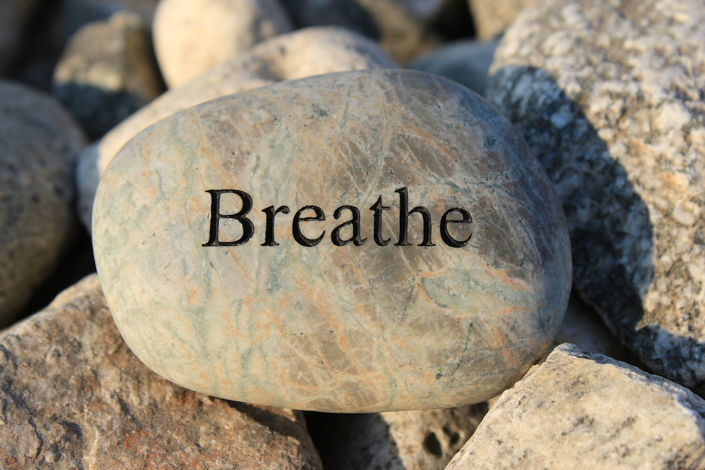 "Rock with the word ""breathe"" on it"